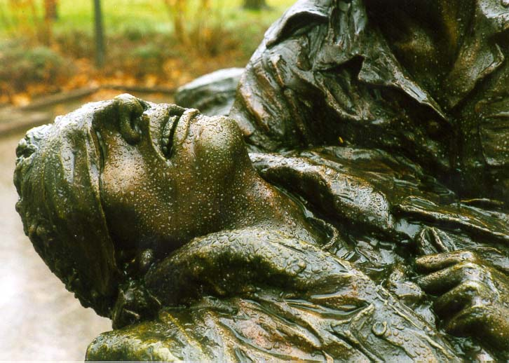 A bronze sculpture in Vietnam War Veterans Memorial at rainy day. Washington DC