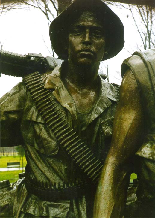 A bronze Statue of the Three Servicemen in...Memorial at rainy day. Washington DC