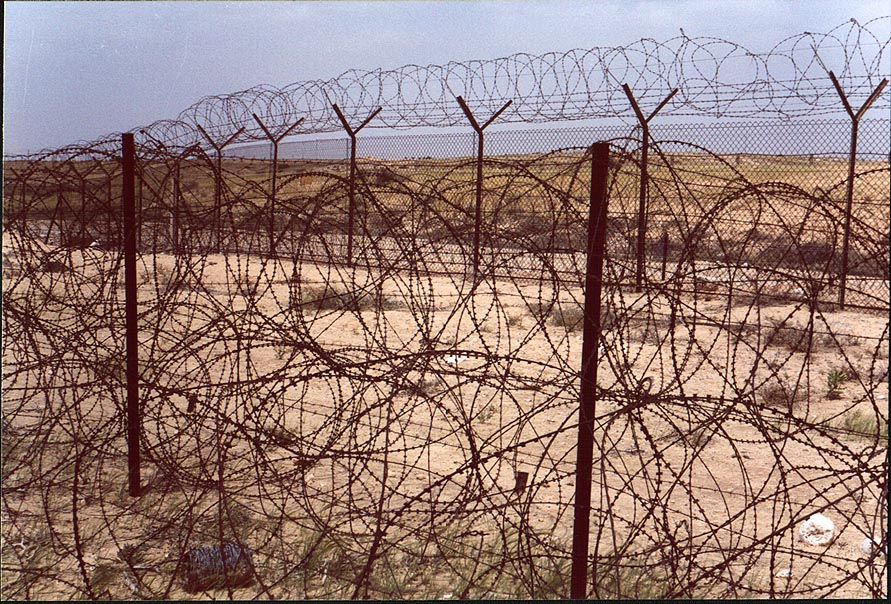 Bunches of barbed wire in Negev Desert in...installation). The Middle East