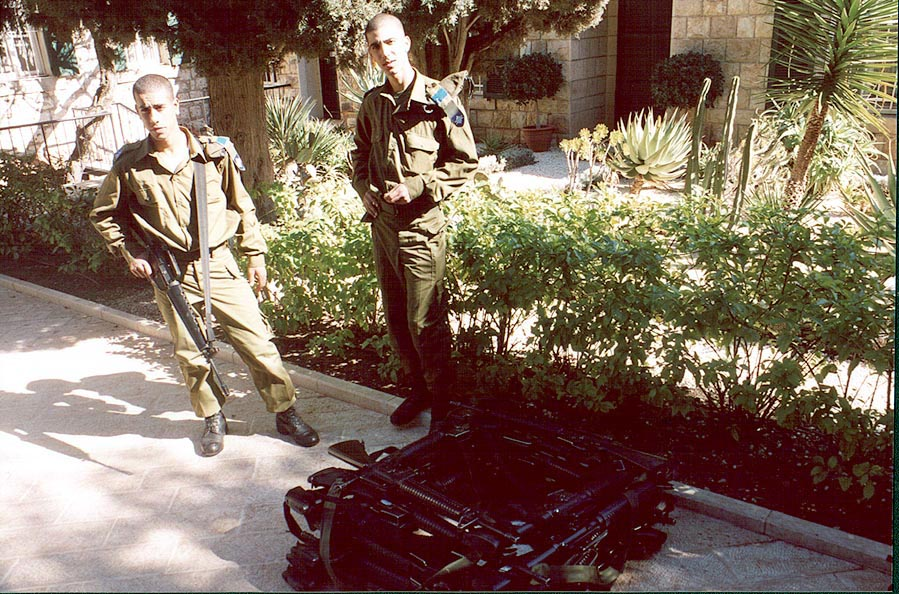 Israeli soldiers with a pile of machine guns at...Mount Carmel. Haifa, the Middle East