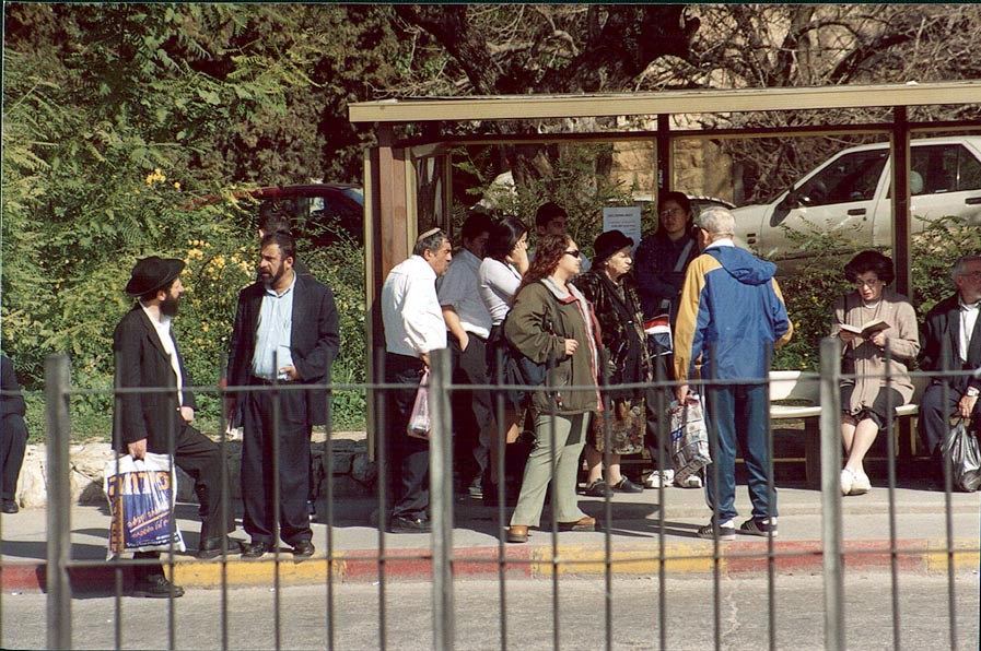 People waiting a bus in Jerusalem. The picture...a bus by a zoom lens. The Middle East