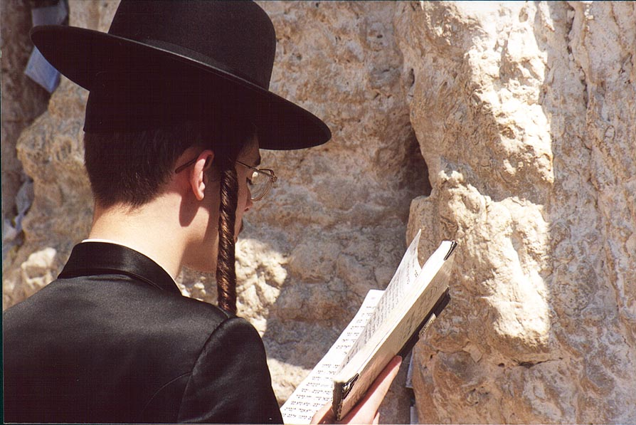 A Jew praying at Western, or wailing Wall during...holiday. Jerusalem, the Middle East