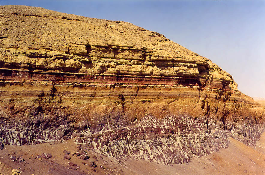 Multicolored cliff in Ramon Crater west from...from a jeep track. The Middle East