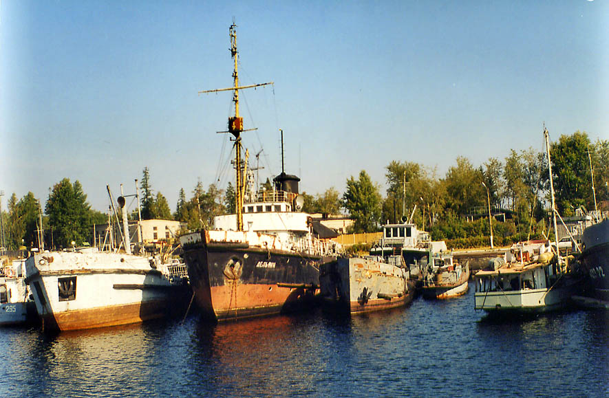 Rusty military ships in Vladimirskaya Bukhta...miles north from St.Petersburg, Russia