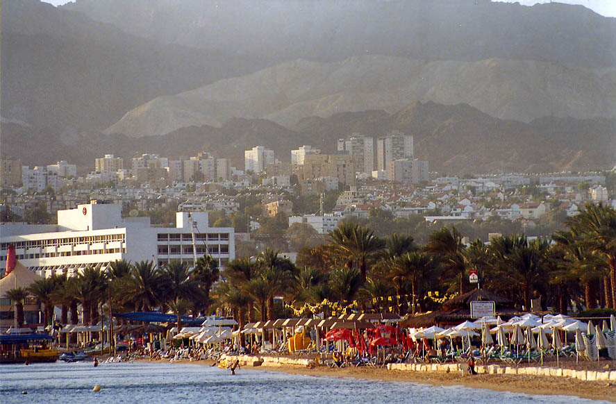 Eilat beach, the city and mountains from sea promenade. The Middle East