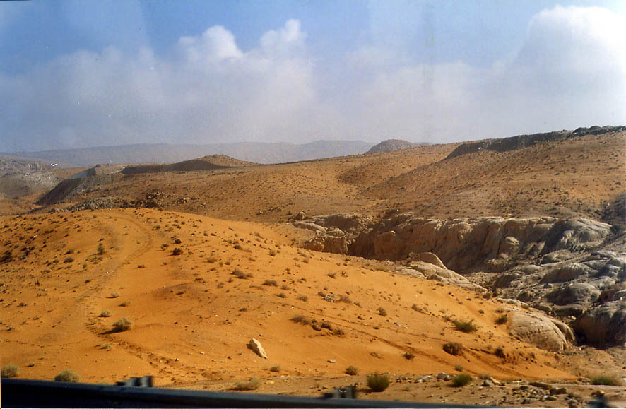 A desert along a road from Akaba to Petra, view from a bus. Jordan