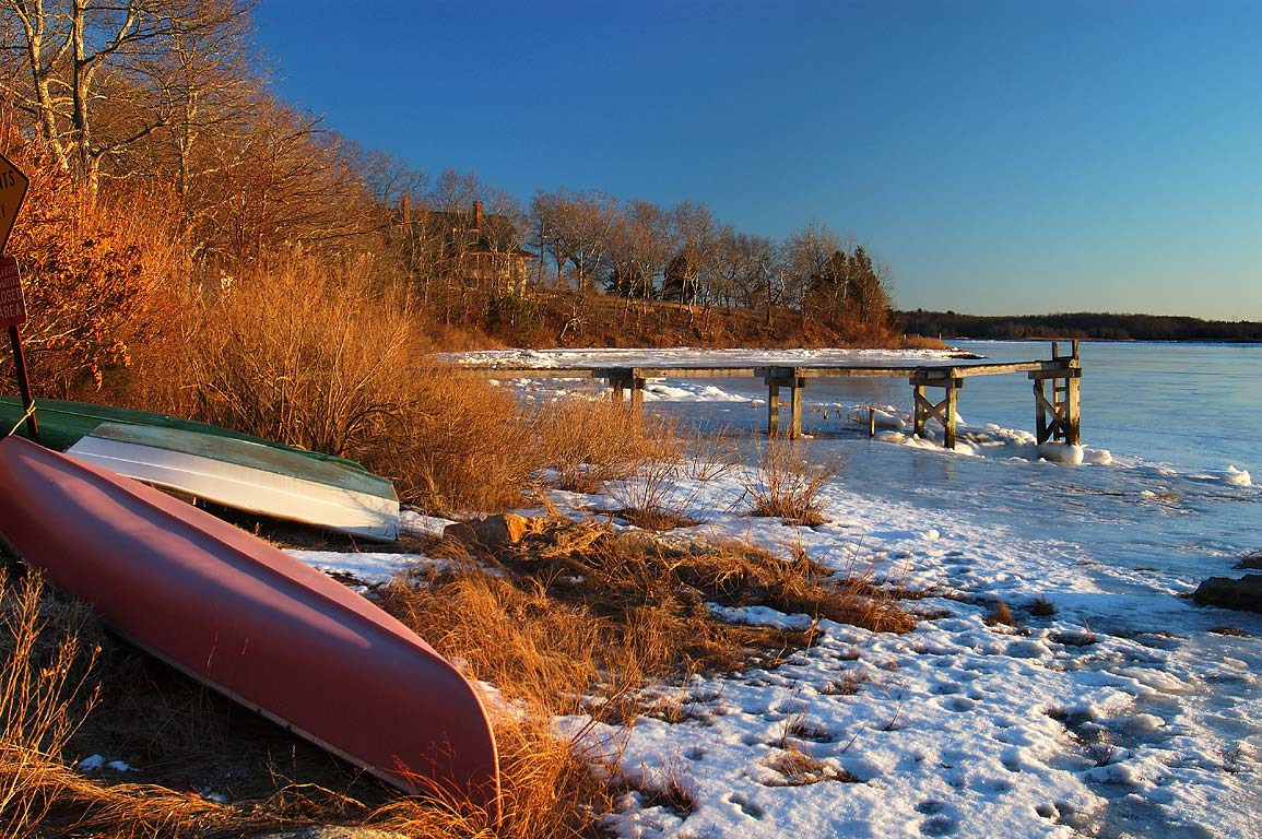 Boats and frozen Slocum's River at the end of Gaffney Rd.. Dartmouth, Massachusetts