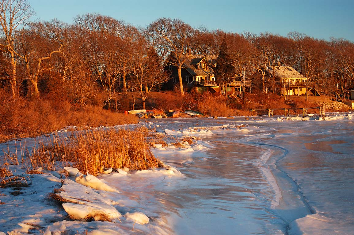 A village and frozen Slocums River at the end of Gaffney Rd.. Dartmouth, Massachusetts