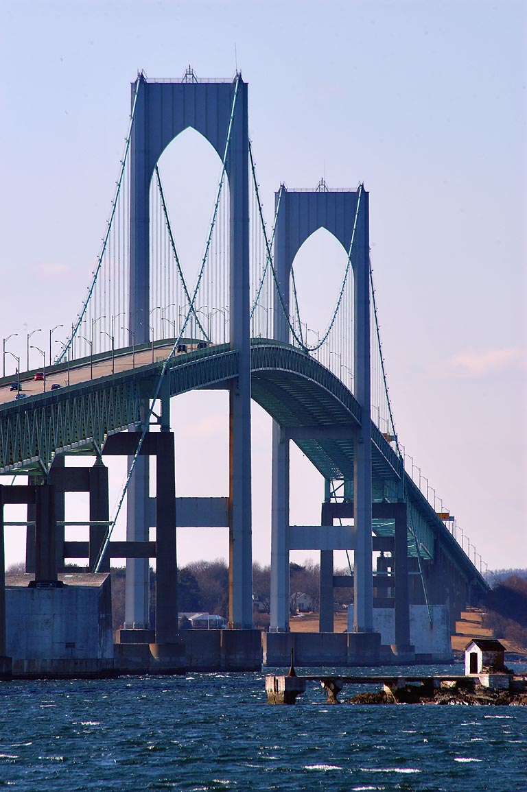 Newport Bridge and oil house of Gull Rocks Light...of zoom lens. Newport, Rhode Island