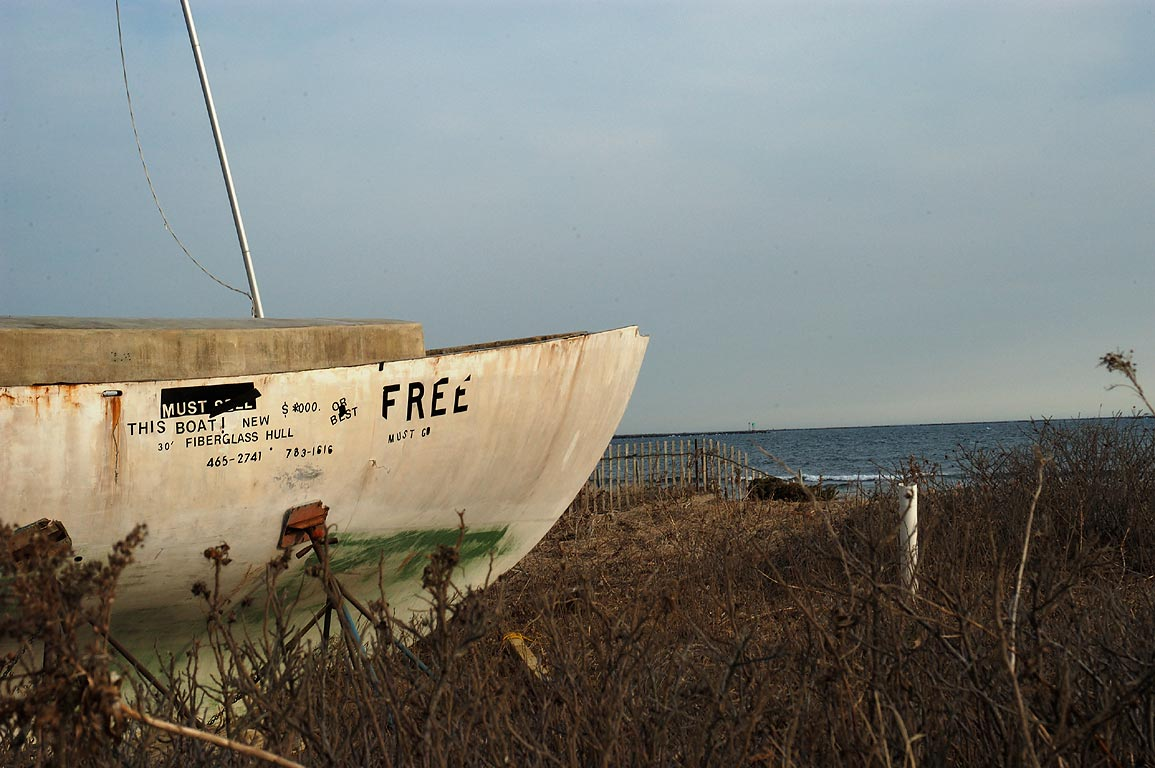 30' fiberglass hull of a boat for sale on...Beach. South Kingstown, Rhode Island