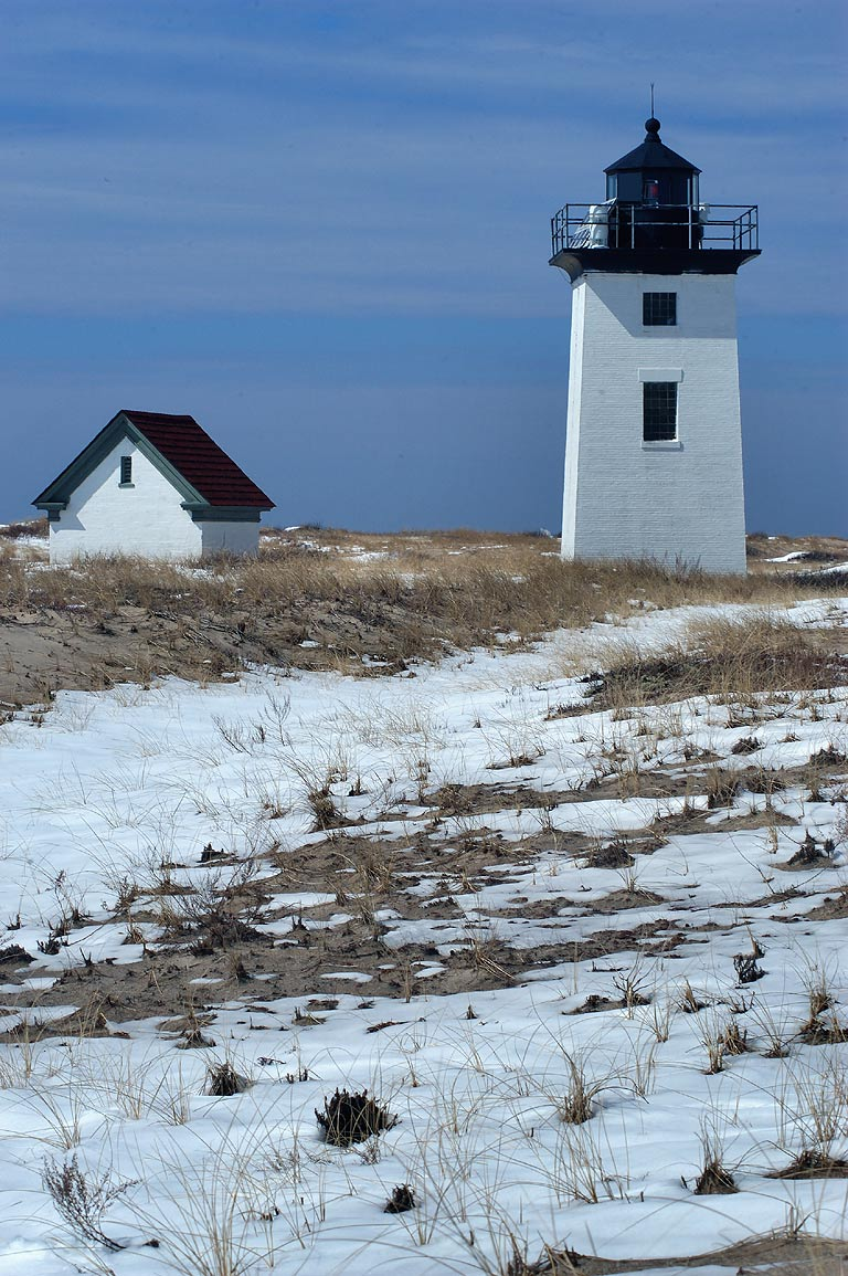 Woods End Lighthouse in Cape Cod after snowfall. Provincetown, Massachusetts