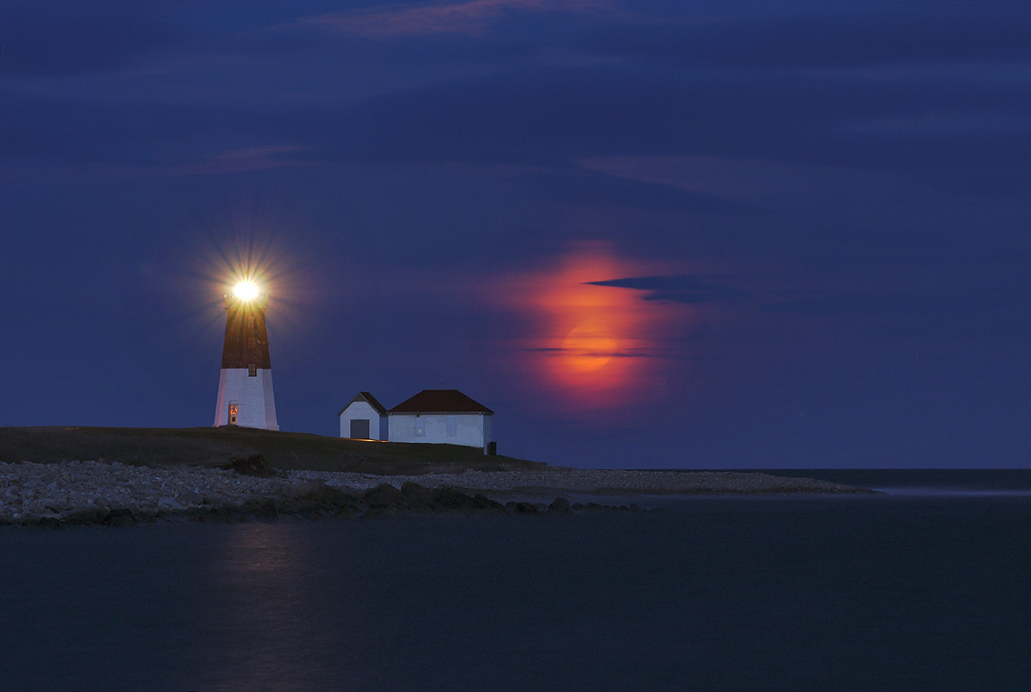 Moonrise over Point Judith in Narragansett, view from a jetty. Rhode Island