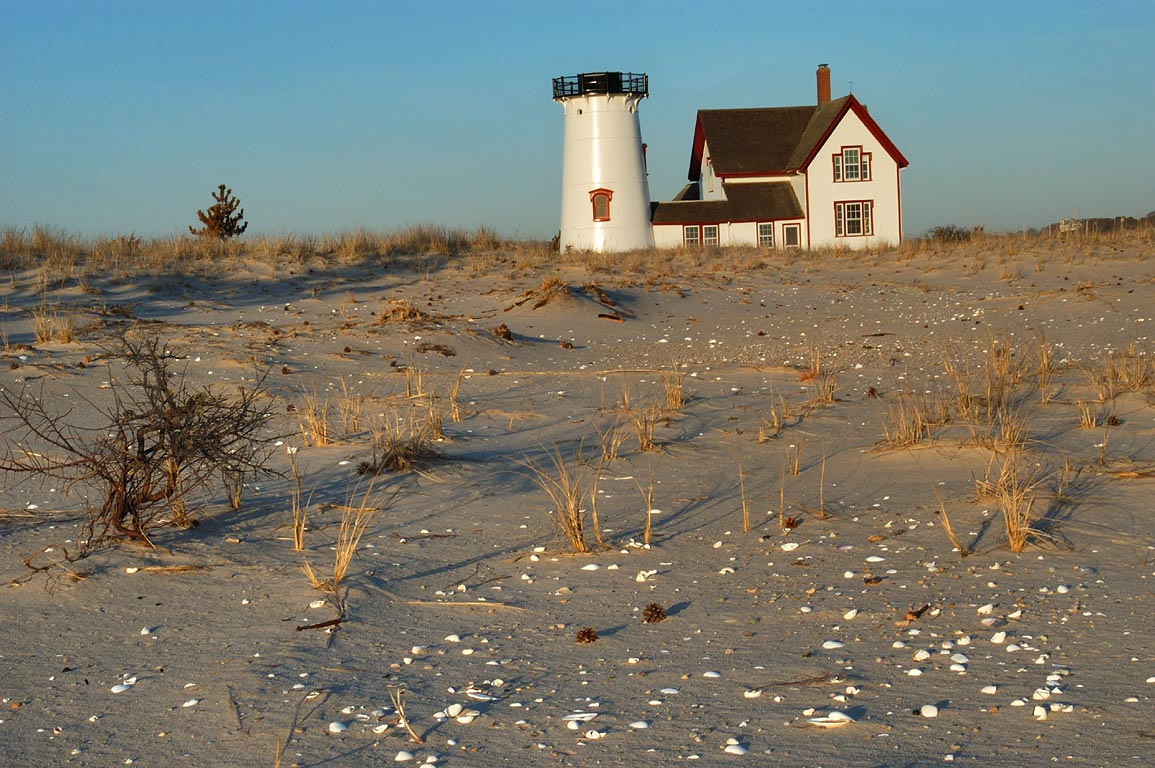 Stage Harbor Lighthouse on Harding Beach in Cape Cod at evening. Chatham, Massachusetts