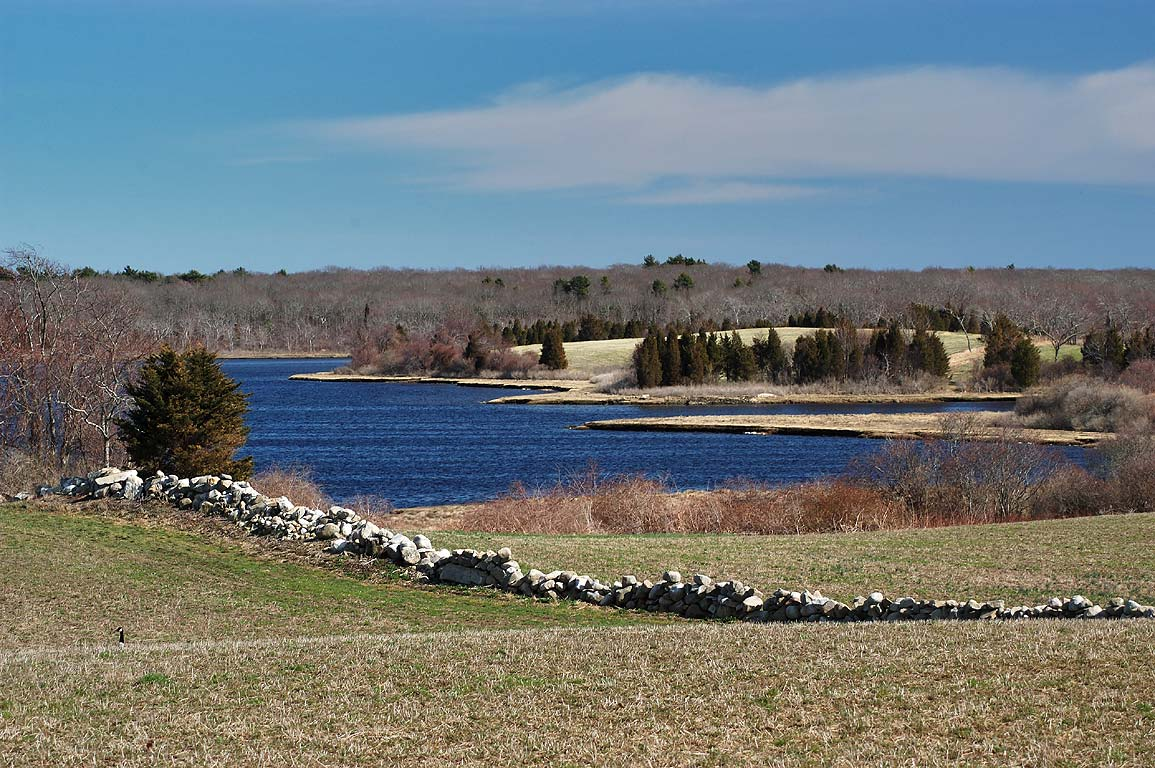 A pasture and Slocums River in Slocums River Reserve. Dartmouth, Massachusetts
