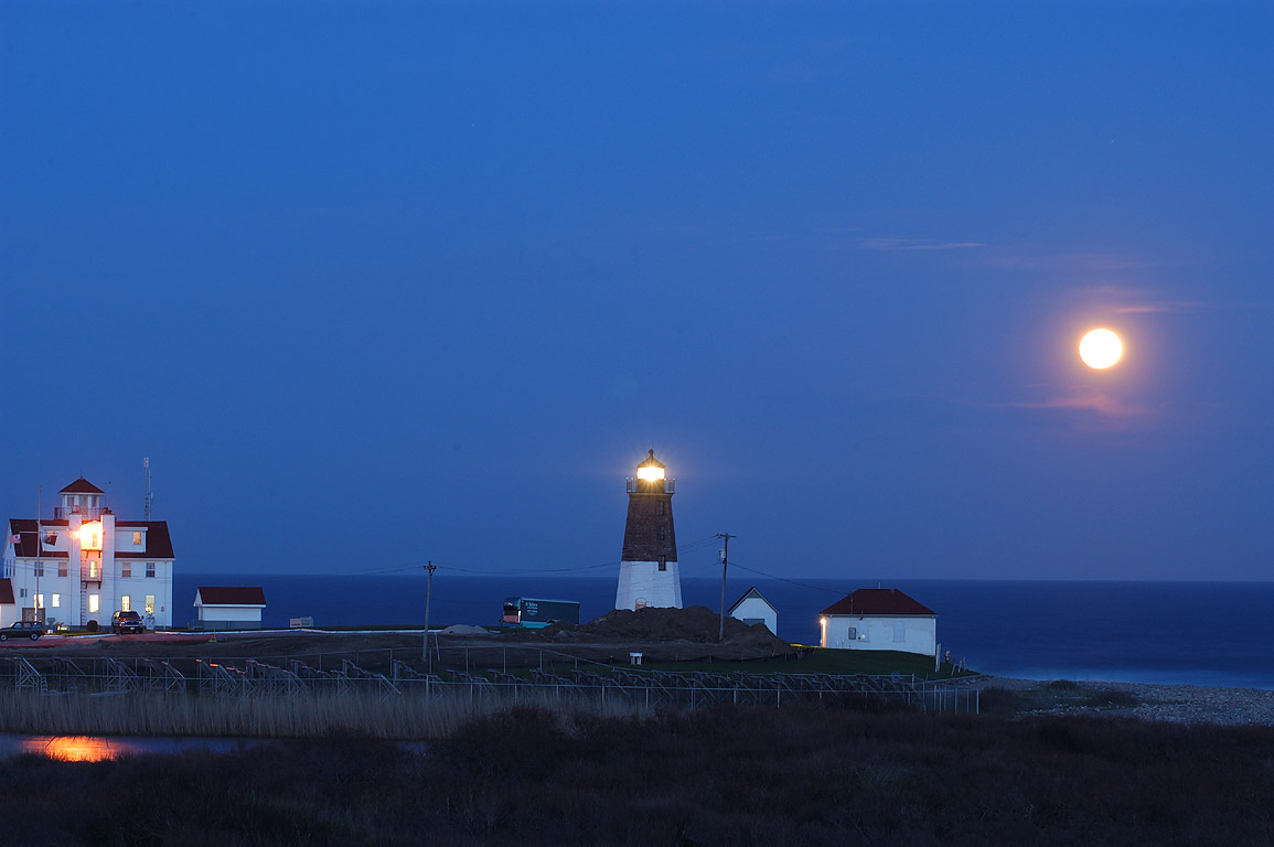 Moonrise with Point Judith Light and coastal...view from a WWII bunker. Rhode Island