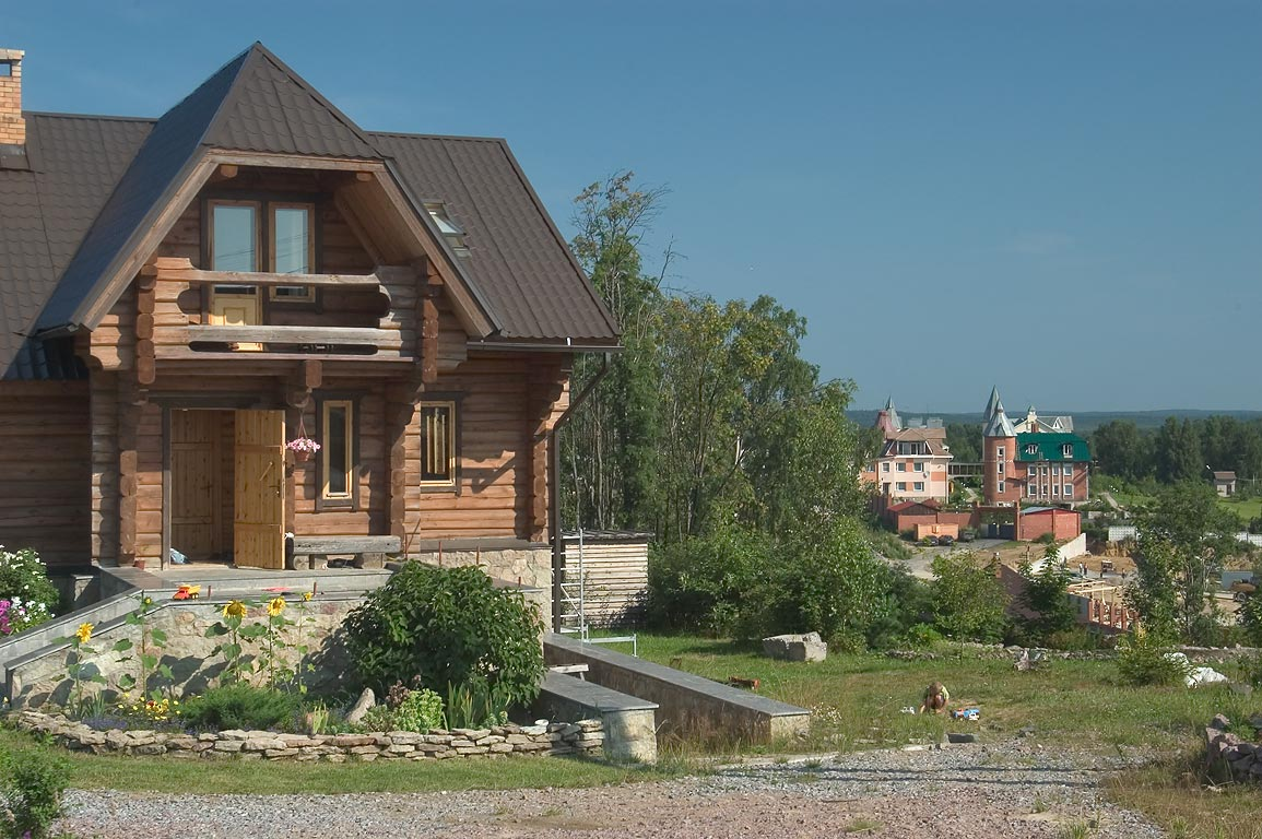 Raising summer houses of affluent businessmen...miles north from St.Petersburg. Russia