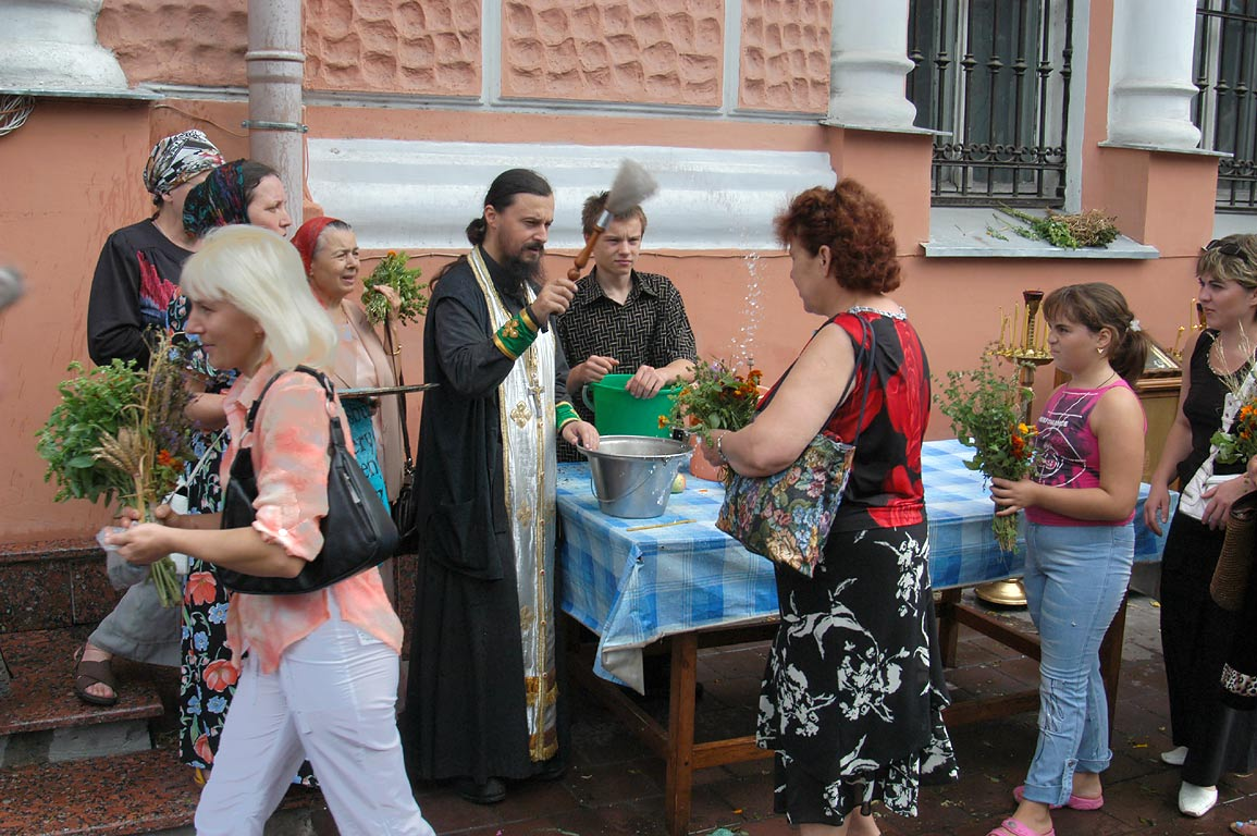 A priest of Panteleymon Cathedral sprinkles...the Honey Saviour. Odessa, Ukraine