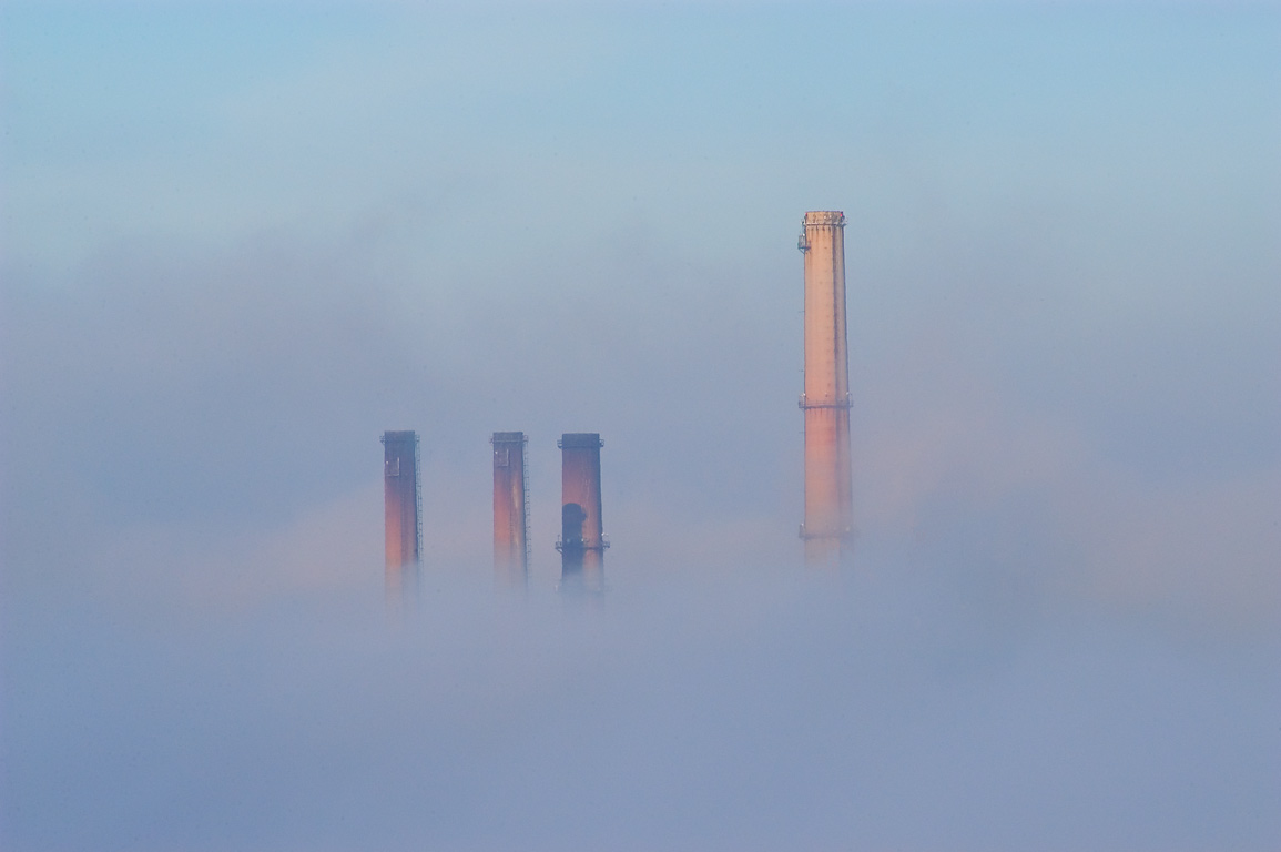 Brayton Point powerplant in fog (zoomed) from an...at morning. Fall River, Massachusetts