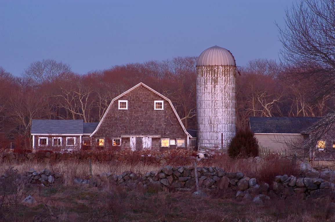 A barn and a silo at dusk, view from Horseneck Rd.. Westport, Massachusetts