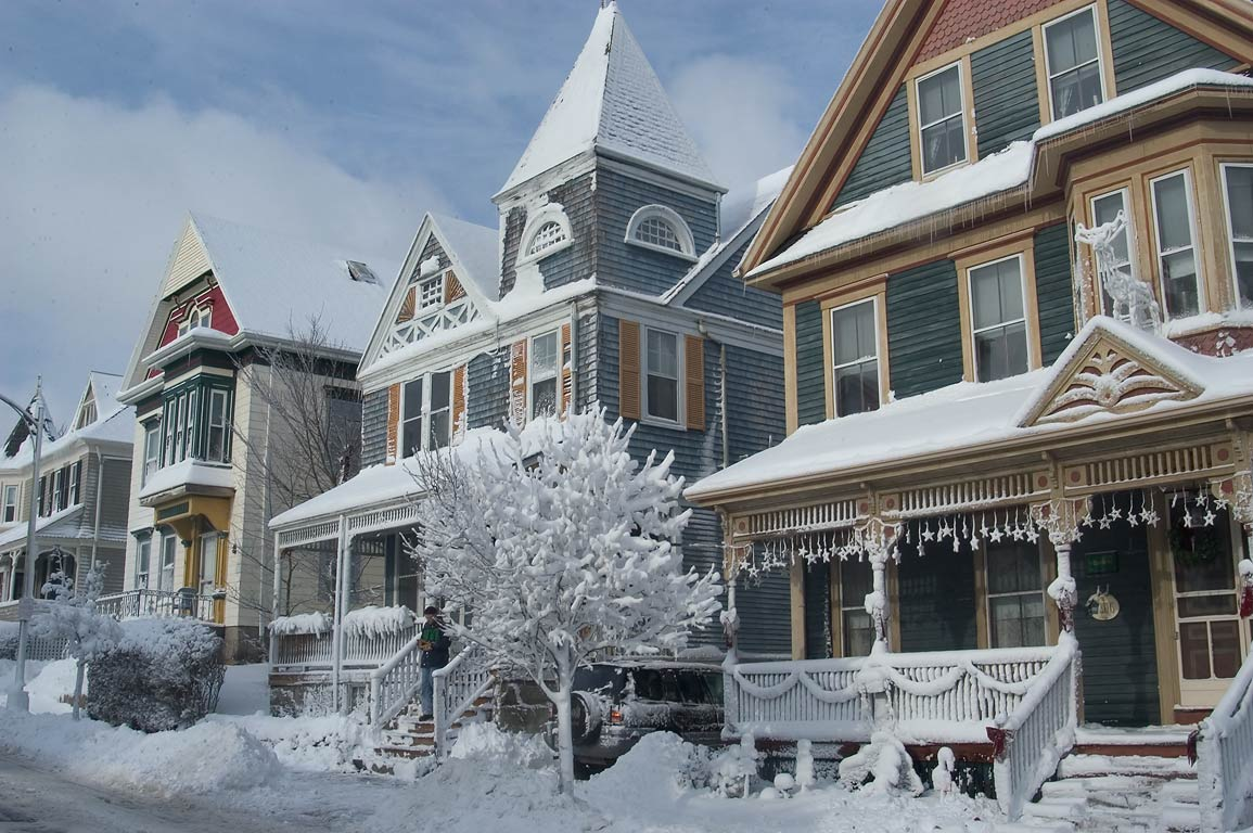 Houses on Mill St. after snowfall, with Christmas decorations. New Bedford, Massachusetts