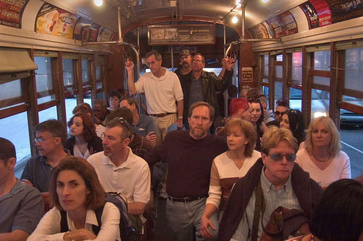 Passengers of St.Charles streetcar during a stop...near Canal St.. New Orleans, Louisiana