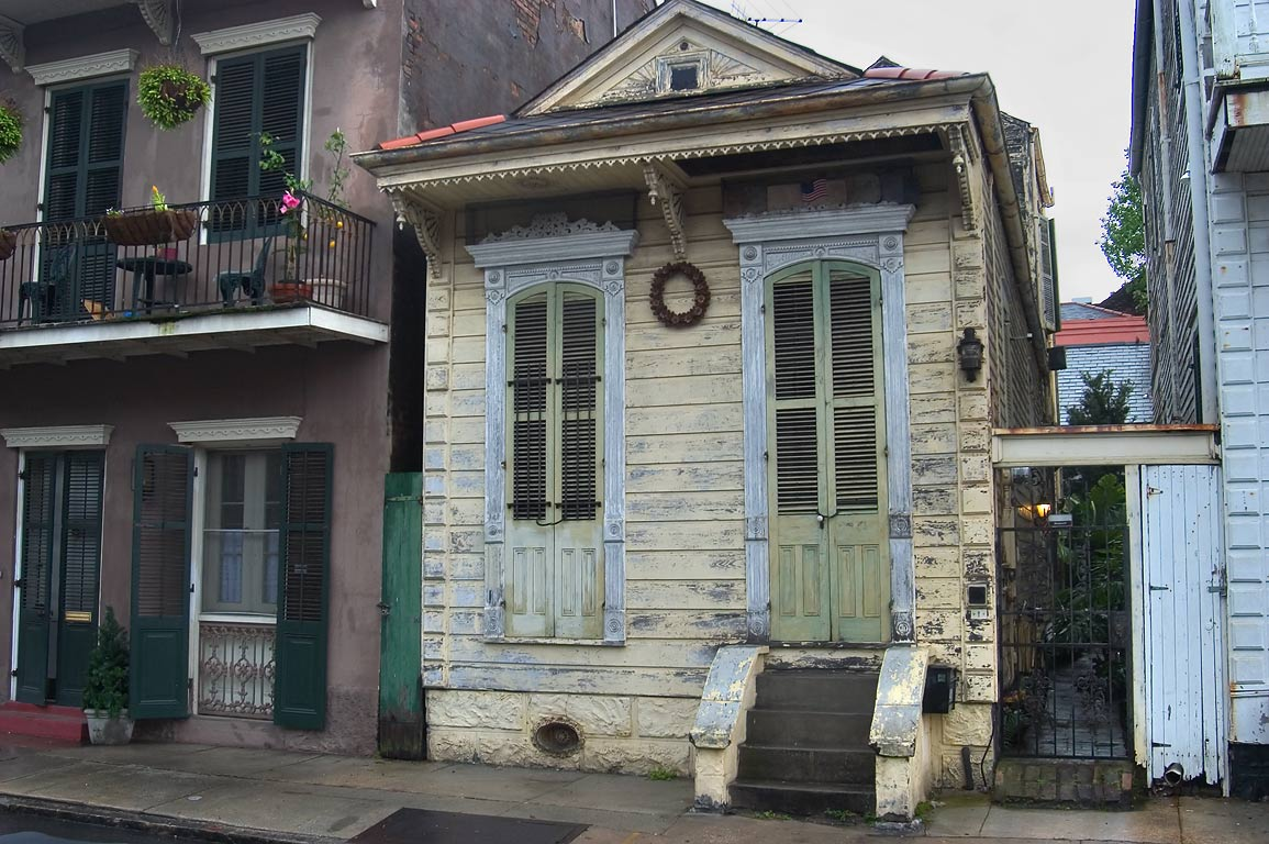 Shotgun house next to 712 Barracks St. in French Quarter. New Orleans, Louisiana