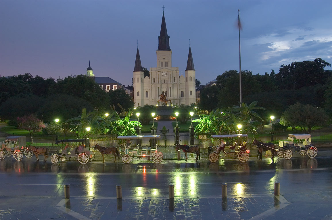 Jackson Square with carriages and St.Louis...Artillery Park. New Orleans, Louisiana