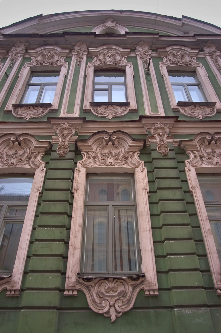 A facade of an old house near Kirochnaya Street. St.Petersburg, Russia