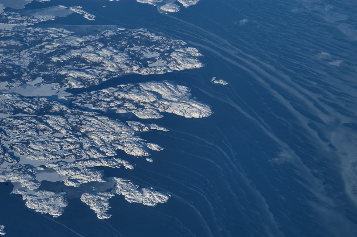 Fishing Ship Harbour and Labrador Sea east from...of a plane from London to Boston