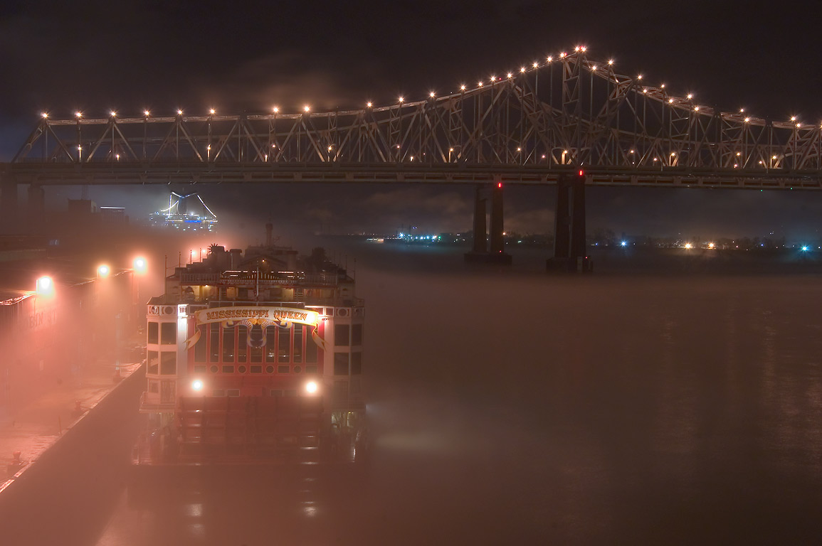 A bridge, Mississippi River, and Robin St. wharf...at night. New Orleans, Louisiana