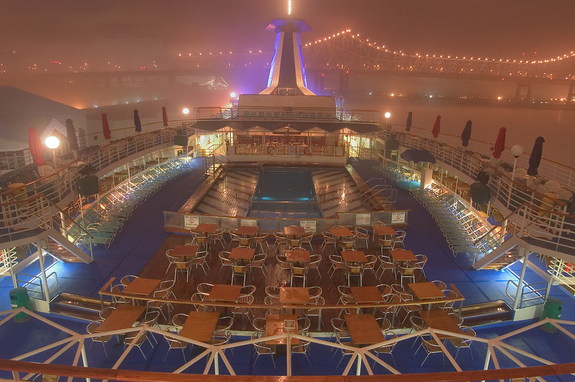 Upper deck with entertainment facilities of...fog at night. New Orleans, Louisiana
