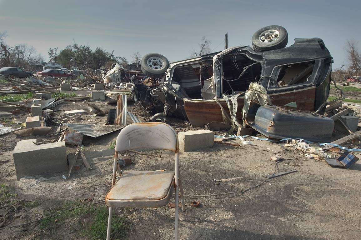 A foundation and a junk car near Reynes St. in Lower Ninth Ward. New Orleans, Louisiana
