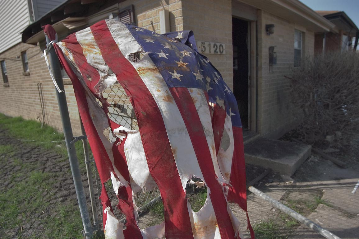 A makeshift memorial with an American flag at...Ninth Ward. New Orleans, Louisiana