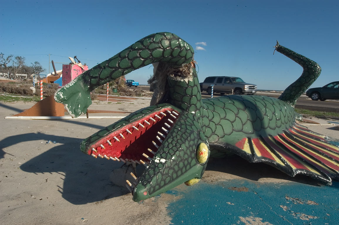 "A broken dragon in a playground of ""Fun Time USA...of Cowan Rd. in Gulfport. Mississippi"