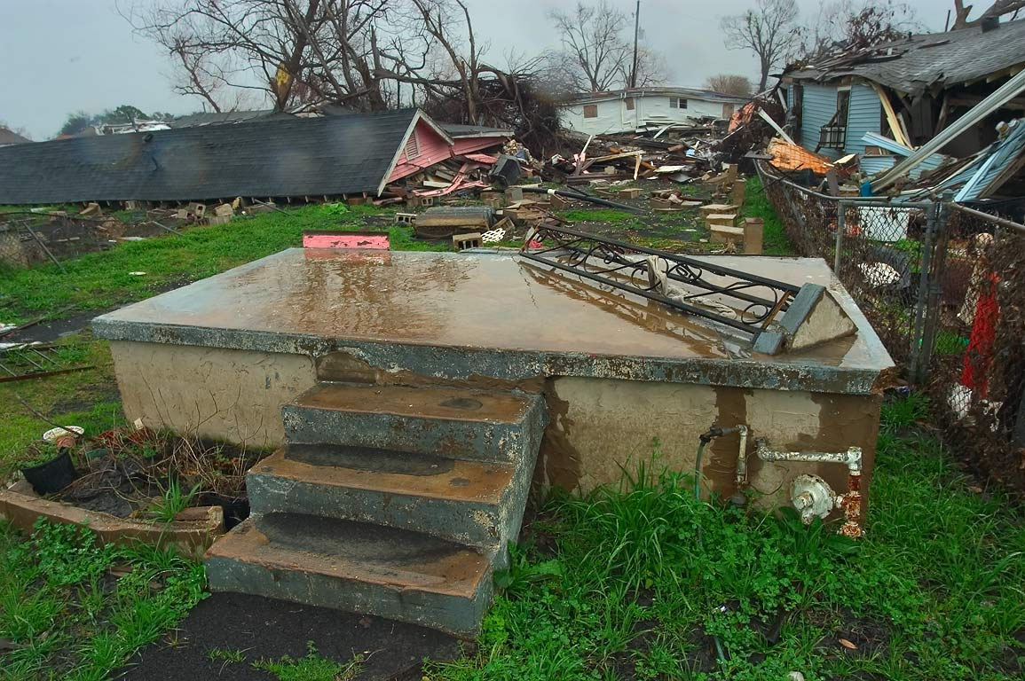 A stone stoop, a foundation, and a roof of a...Ninth Ward. New Orleans, Louisiana
