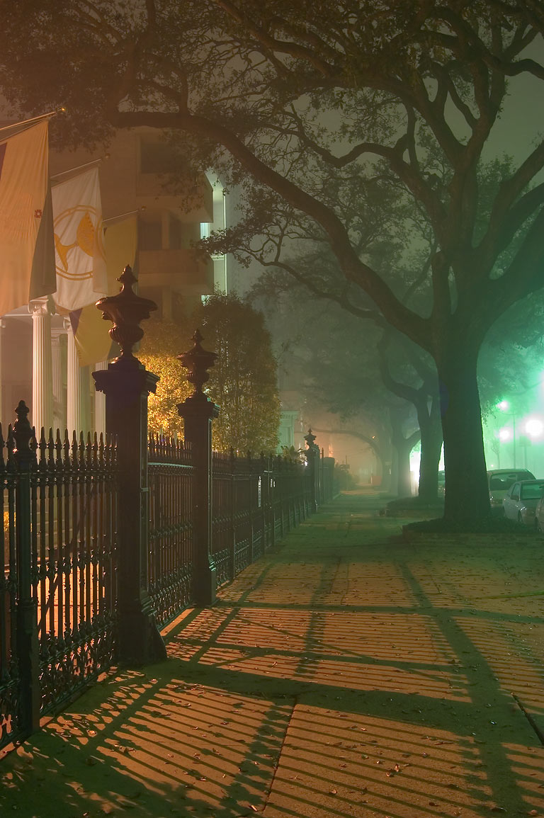 Foggy sidewalk near Morris-Downman House at 2525...at night. New Orleans, Louisiana