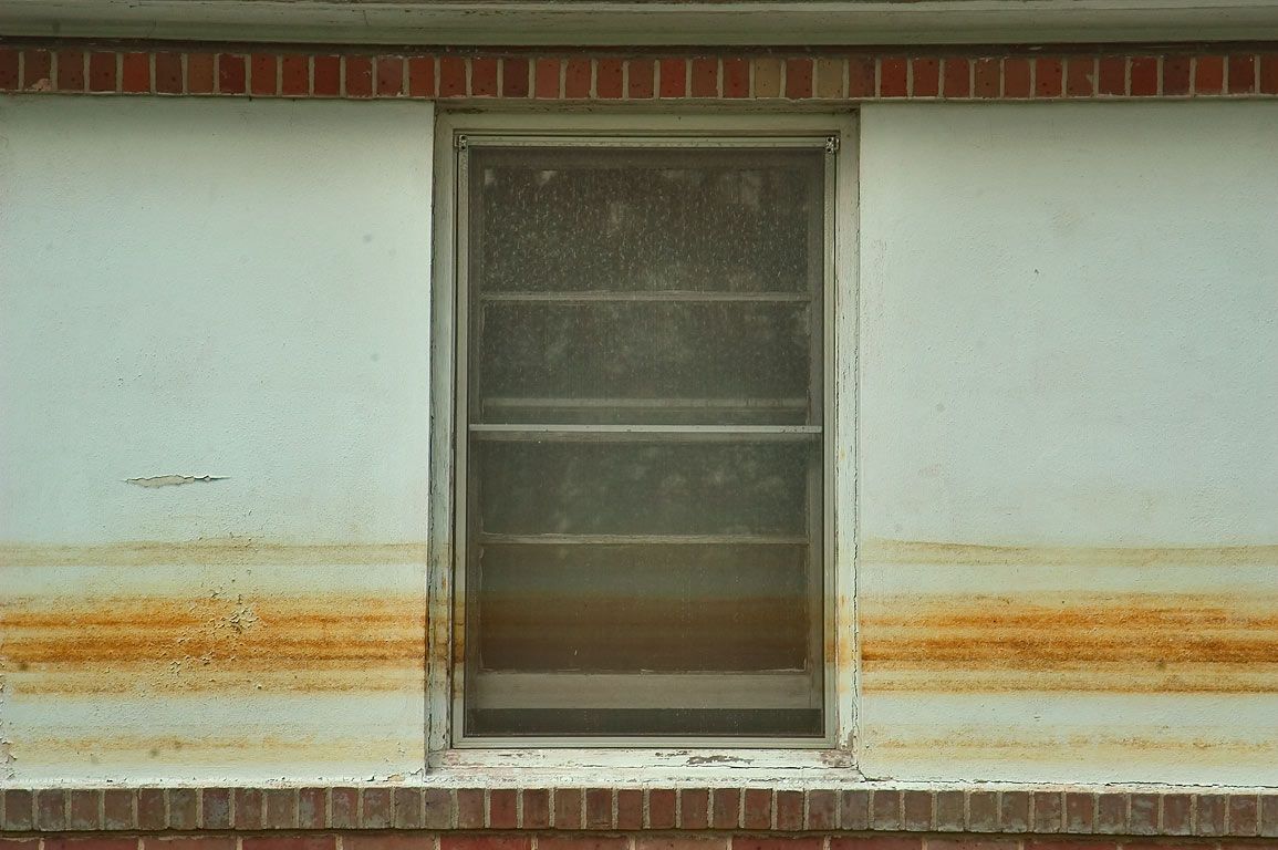 Waterlines on a window of a house at Canal Blvd.. New Orleans, Louisiana