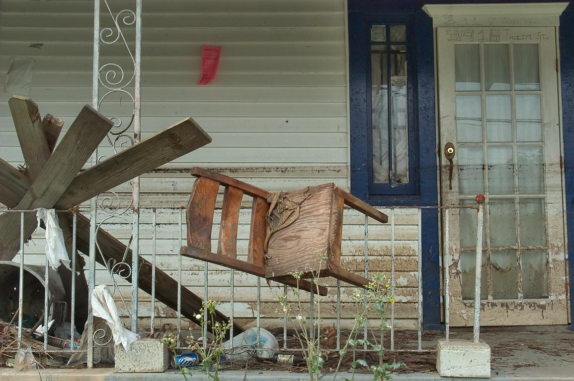 Levitating chair on a porch of a house at 3918...Central City. New Orleans, Louisiana