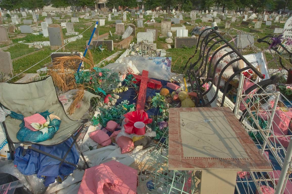 An odd assemblage of objects on a tomb decorated...Cemetery. New Orleans, Louisiana