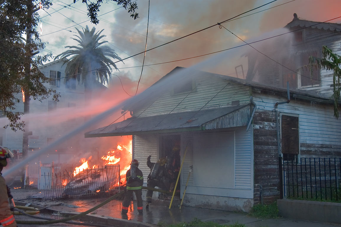 Firefighters working at 1231 St.Mary St., corner...District. New Orleans, Louisiana