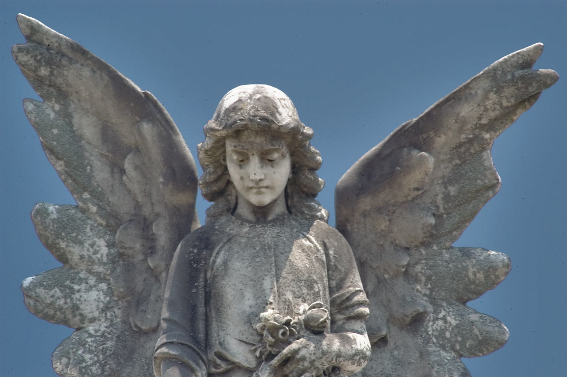 An angel on a tomb in Metairie Cemetery. New Orleans, Louisiana