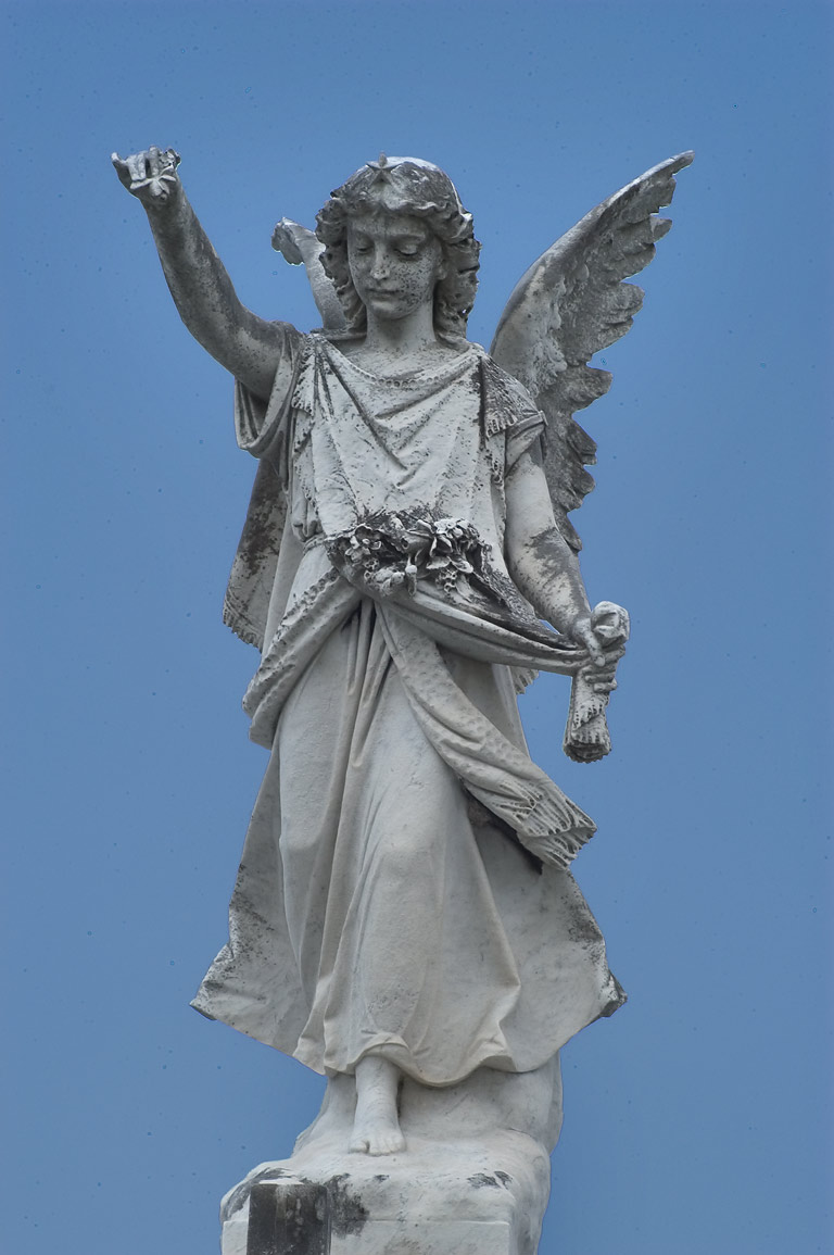 An angel on a tomb of Anthony Foto in Metairie Cemetery. New Orleans, Louisiana