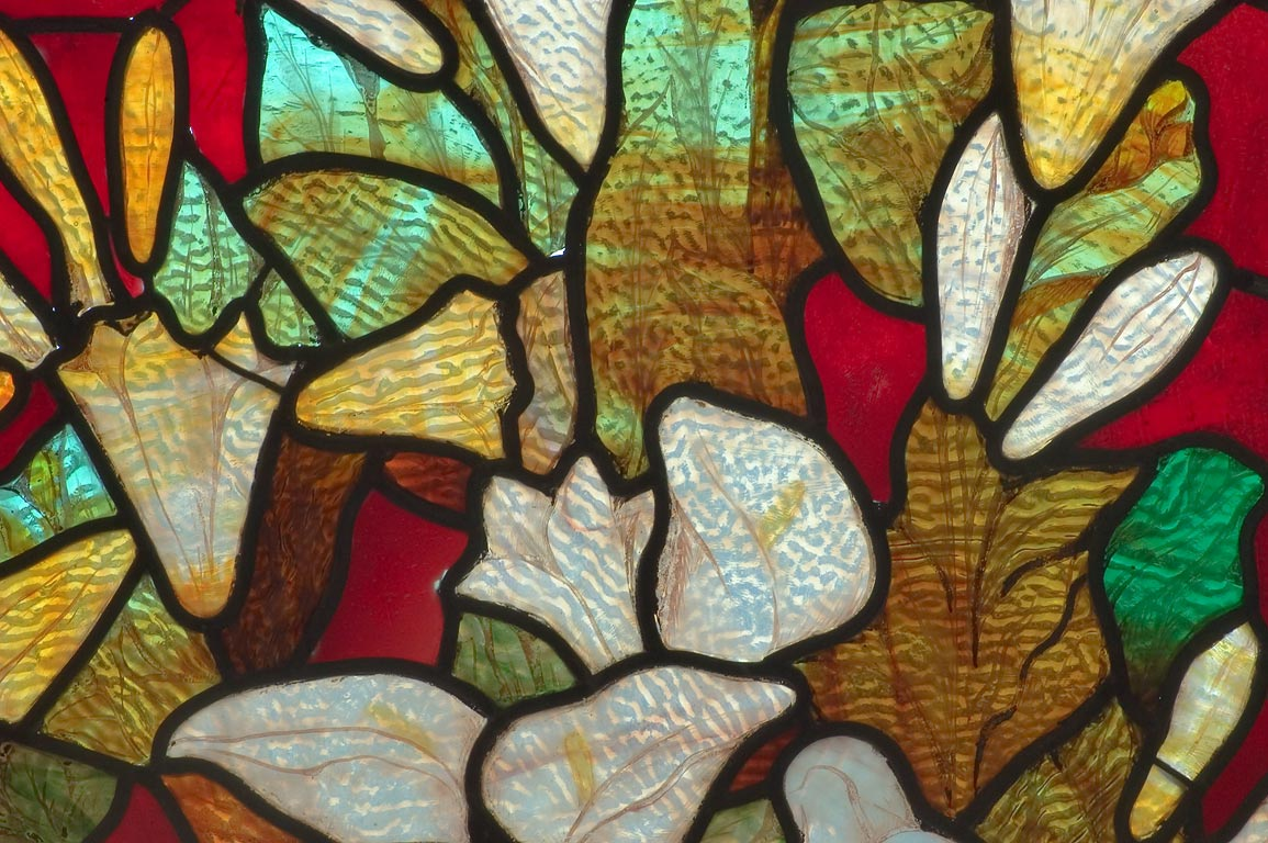 Leaves and flowers on stained glass of a crypt of...Cemetery. New Orleans, Louisiana
