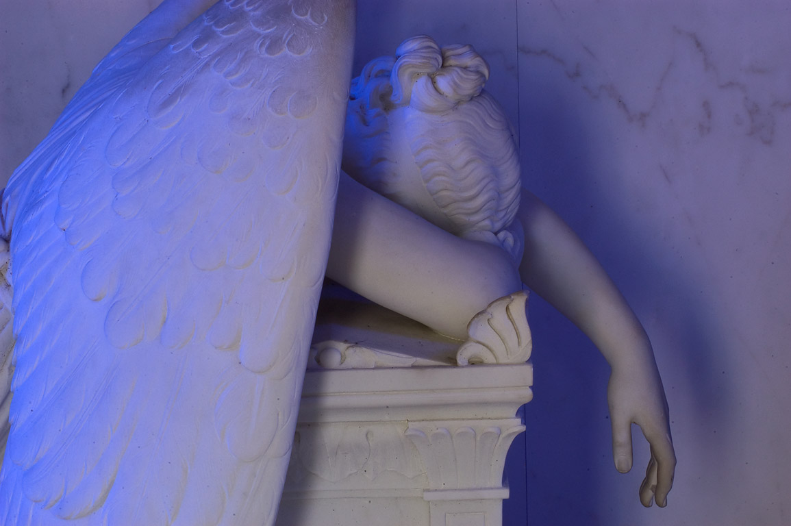 A statue of a weeping angel in a crypt of Chapman...Cemetery. New Orleans, Louisiana