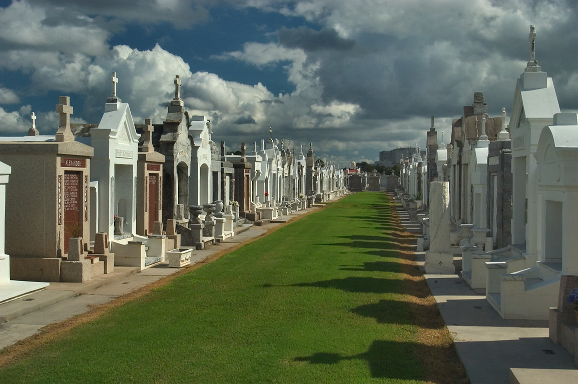 A grassy lane in St.Louis Cemetery No. 3. New Orleans, Louisiana