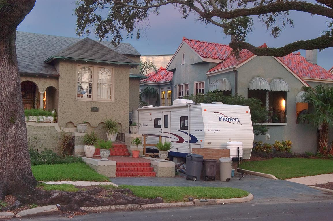 A house with FEMA trailer on Audubon Blvd. near...at evening. New Orleans, Louisiana