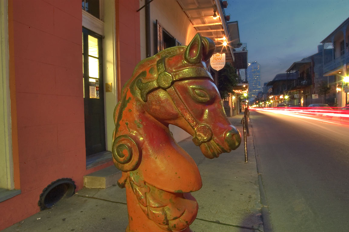 Red horse hitch on Royal St. near Dumaine St. in French Quarter. New Orleans, Louisiana