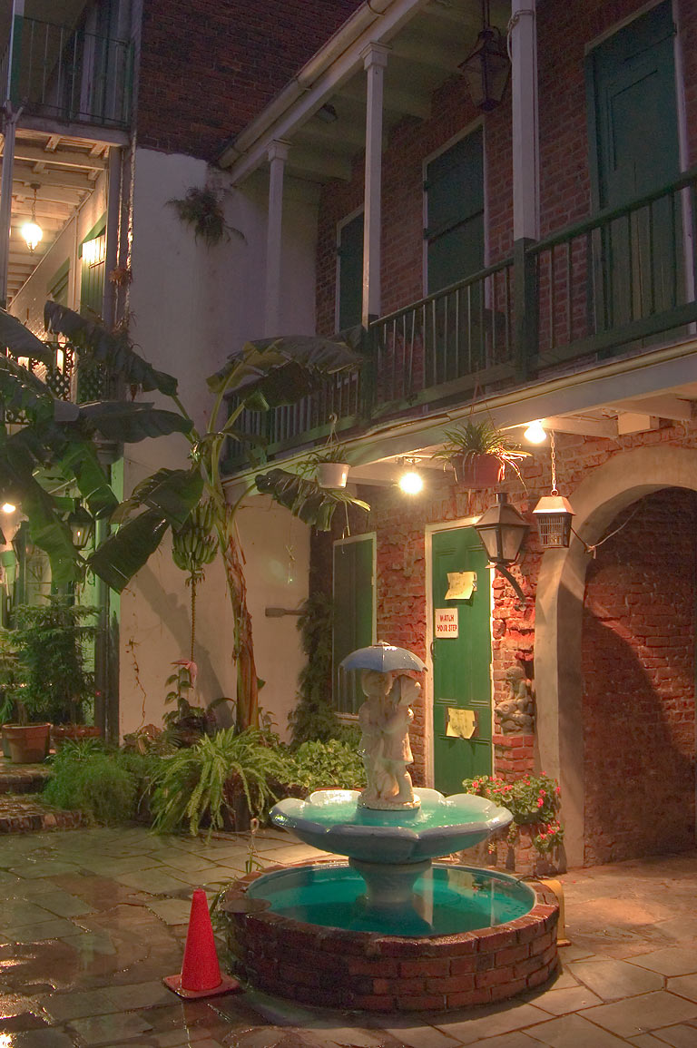 A courtyard on St.Peter St. near Bourbon Street in French Quarter. New Orleans, Louisiana