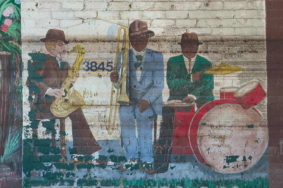 Jazz band with flood lines among inmate murals...Tulane Ave.. New Orleans, Louisiana