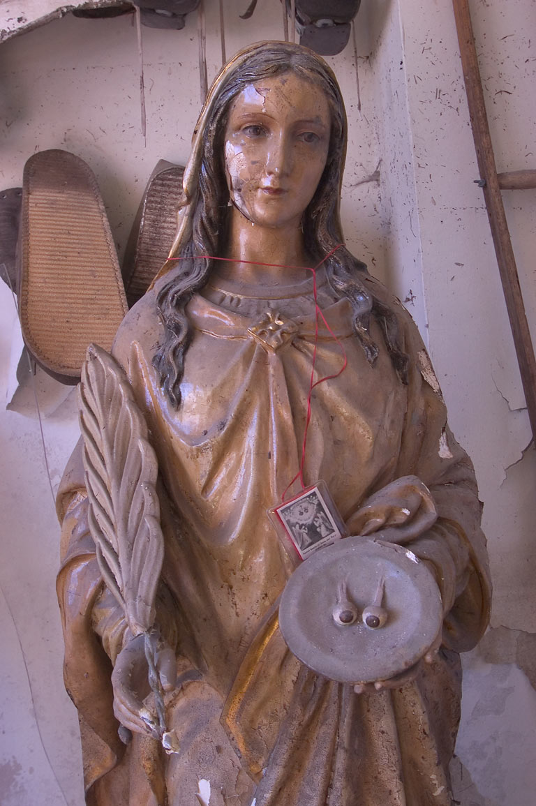 A statue of St. Lucy with eyeballs on a plate in...Roch Cemetery. New Orleans, Louisiana